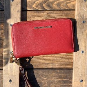 Red Michael Kors Jet Set travel wallet